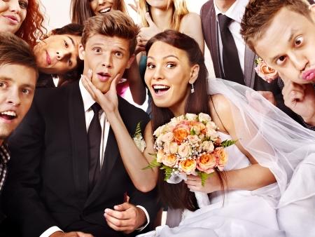 wedding suit: Happy couple perform wedding dance.