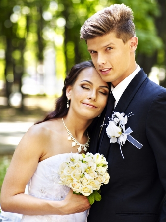 Groom embrace  bride with flower summer  outdoor. photo