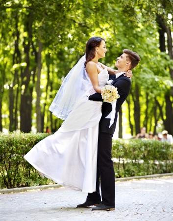 bride bouquet: Bride and groom in park summer  outdoor.