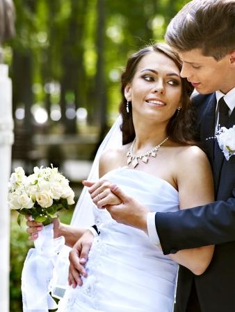 bride groom: Groom embrace  bride with flower summer  outdoor. Stock Photo