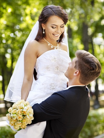 groom and bride: Bride and groom with flower summer  outdoor. Stock Photo