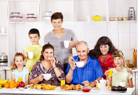Big happy family have breakfast at kitchen. Stock Photo