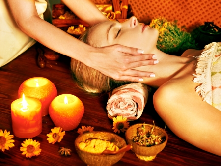 facial treatment: Woman getting facial massage in tropical beauty spa. Stock Photo
