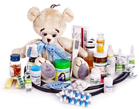 Child medicine and teddy bear. Isolated. photo
