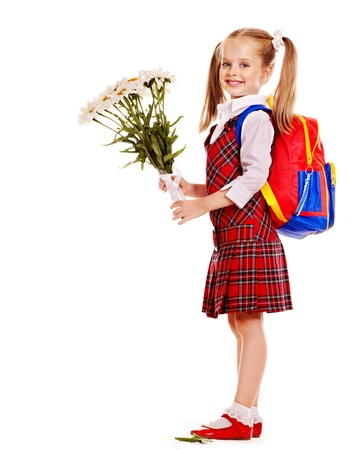 schoolgirl uniform: Happy child with backpack holding flower. Isolated.