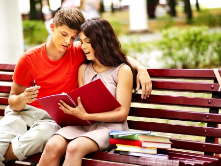 Couple student with notebook summer outdoor. photo