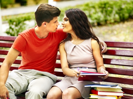 young couple kiss: Couple student with book summer outdoor.