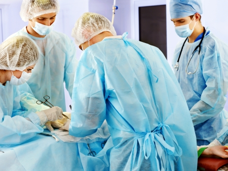 emergency room: Team surgeon at work in operating room.