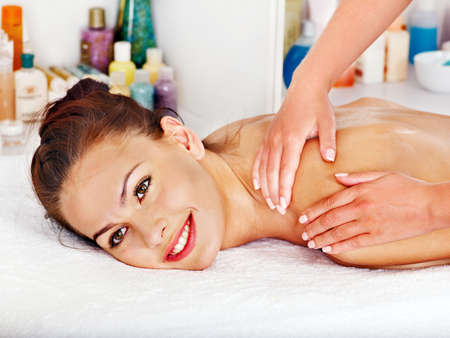 day spa: Woman getting facial  massage in beauty spa.