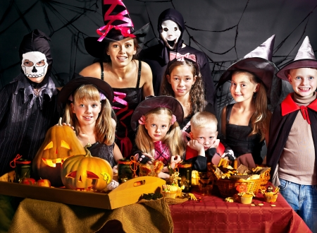 Children on Halloween party  making carved pumpkin Stock Photo - 21558717