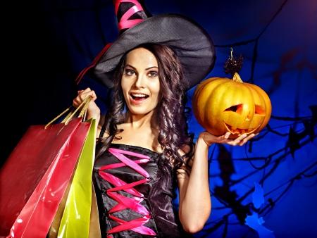 Happy woman holding Halloween shopping bag. photo