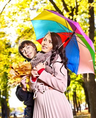 Couple holding umbrella  autumn outdoor. Stock Photo - 22281706