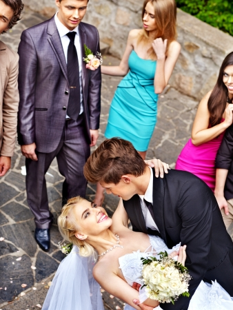 Groom kissing bride . Outdoor. photo