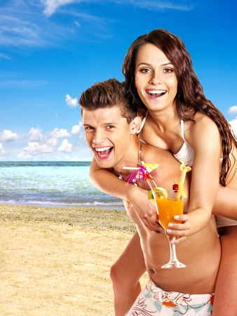 guy on beach: Couple with cocktail at  beach. Summer outdoor.