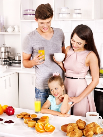 jam: Parents prepare  breakfast for child. Happy family.