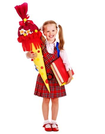 schoolgirl uniform: Child holding book and school cone. Isolated.