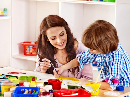 childcare: Family with children  painting  in school. Education. Stock Photo