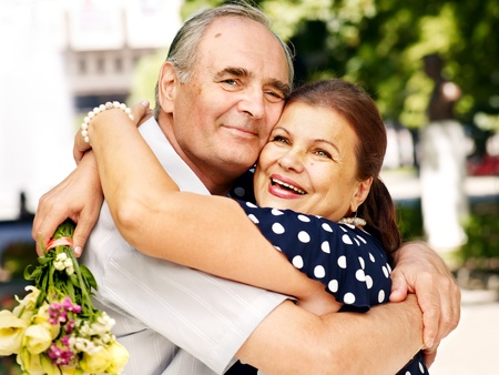 Happy old couple at summer  outdoor. photo