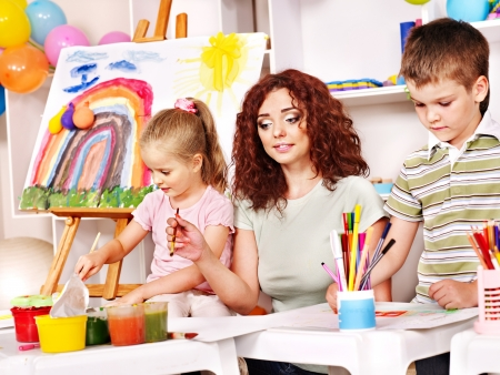 Child with mother painting . Child care. photo