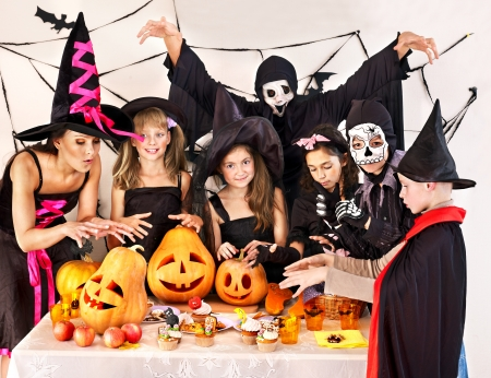 treat: Halloween party with group children holding trick or treat.