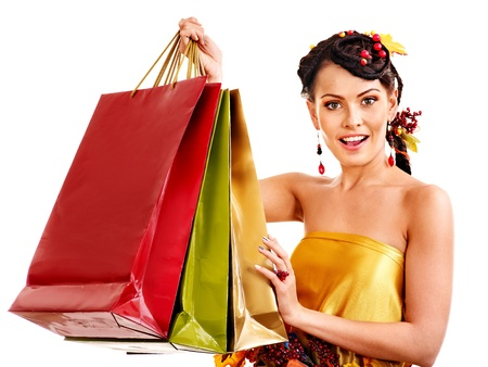Girl with  autumn hairstyle and shopping bag. photo