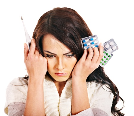tonsillitis: Young woman having pills and tablets. Isolated.