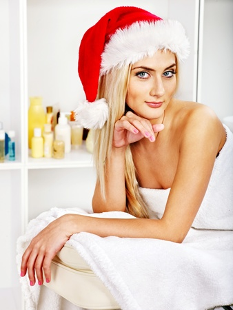 Woman getting massage in Christmas spa. photo