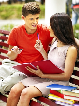 Couple student with book summer outdoor. photo