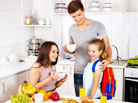 Parents prepare  child for school. Happy family. photo