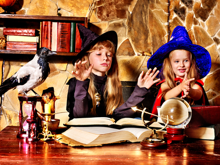 scrying: Witch  children with crystal ball. Halloween.