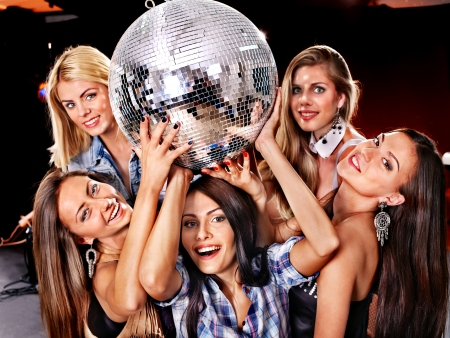 lighting effects musician: Group people on disco in night club. Lighting effects.