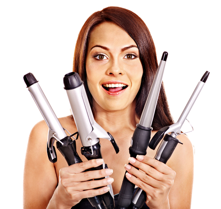 hair curler: Young woman holding iron curling hair. Isolated.