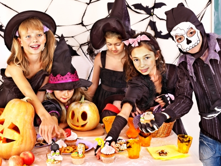 Halloween party with children holding carving pumpkin Imagens