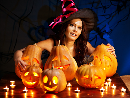 Witch woman with group Jack OLantern.