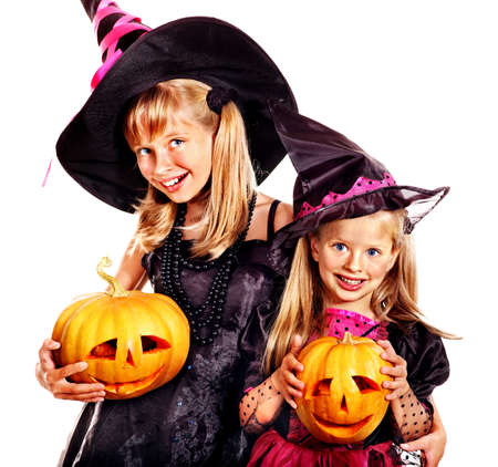 Happy group witch children at Halloween party. photo
