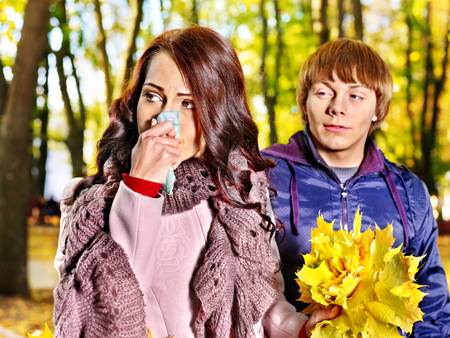 People sneezing handkerchief autumn outdoor . photo