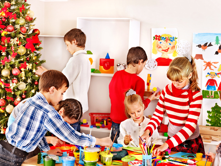 Children in kindergarten stacking block. Christmas. photo
