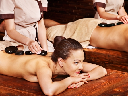 Couple  having stone Ayurveda spa treatment. photo