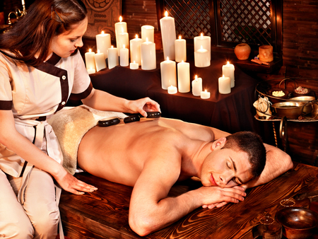 Man  having oil Ayurveda spa treatment. photo