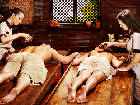 Couple  having oil Ayurveda spa treatment. photo