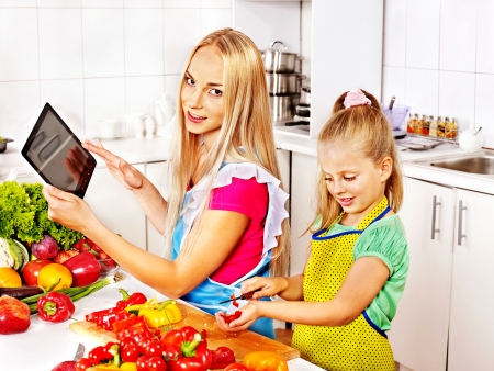 Mother and daughter prepare recipe at kitchen. photo