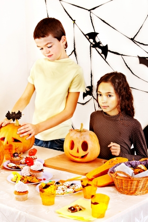 Halloween party with children holding trick or treat  photo
