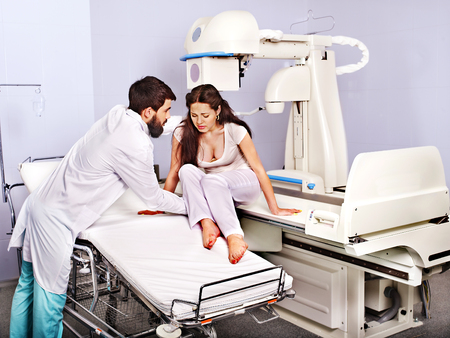 x ray equipment: Doctor checking patient  in x-ray room