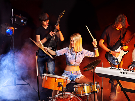 Musical group playing in night club. Male and female. Stock Photo - 22528313