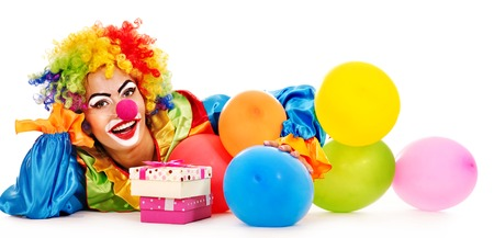 Lying clown with balloon. Isolated. photo