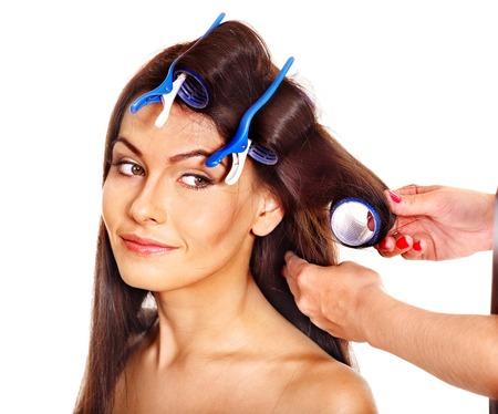 hair curler: Woman wear hair curlers on head. Isolated,