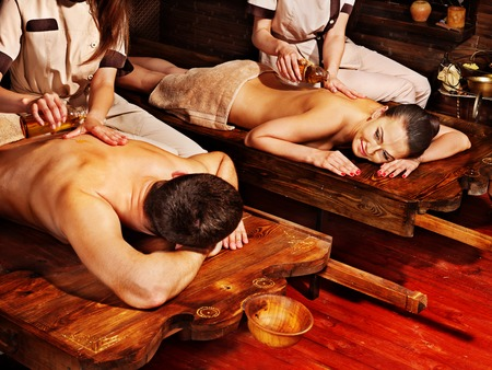 Couple  having oil Ayurveda spa treatment. Stock Photo - 22528610