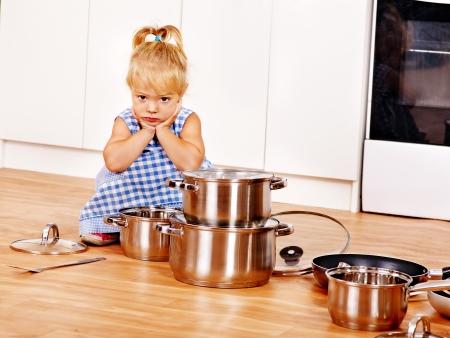 Child holdig group pan at kitchen. Stock Photo - 22528645