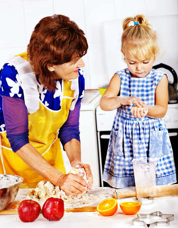 Grandmother and granddaughter baking cookies. photo