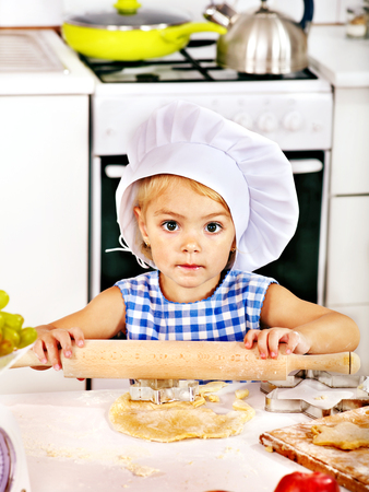 rollingpin: Child with rolling-pin dough at kitchen.